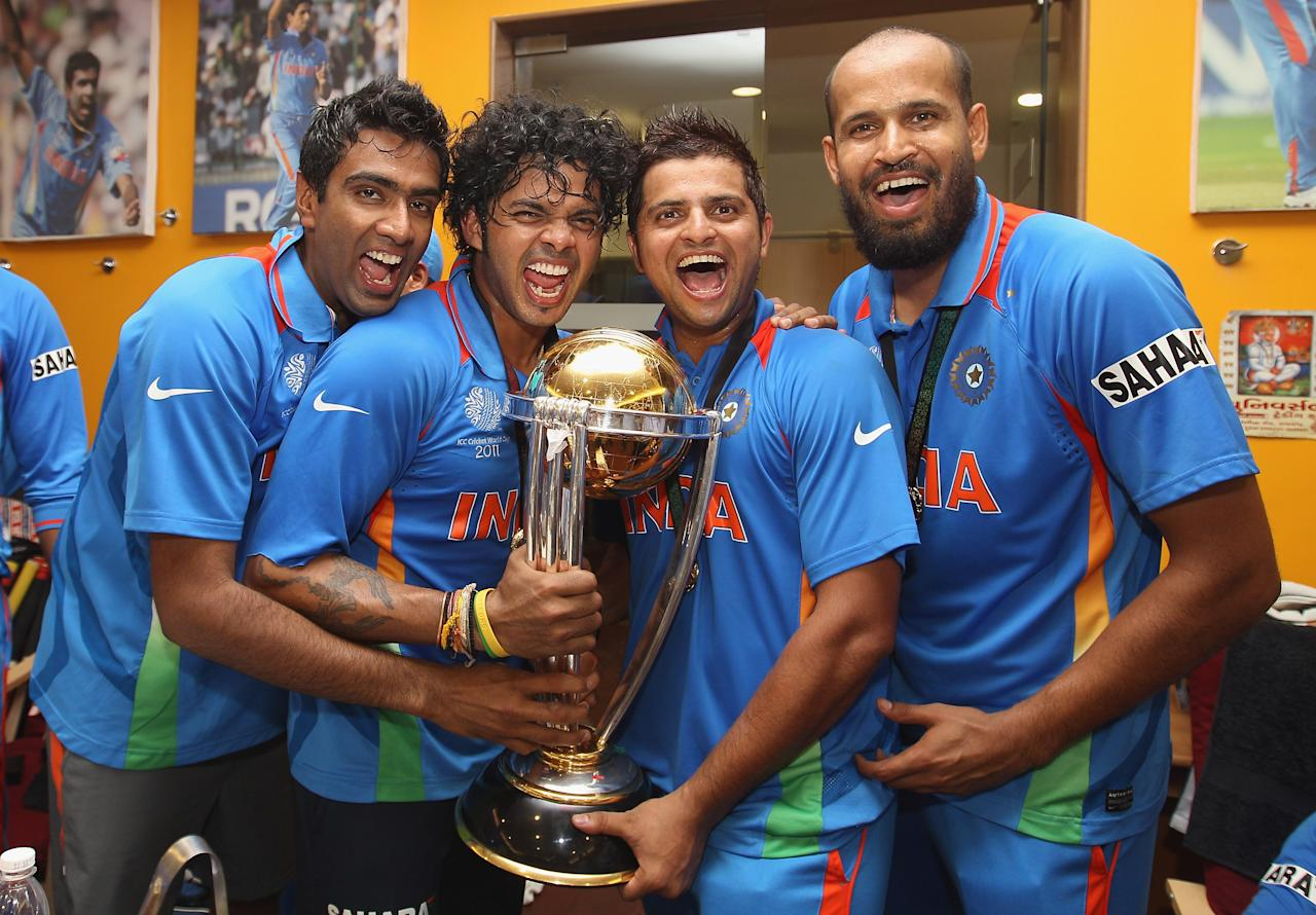 MUMBAI, INDIA - APRIL 02: Ravichandran Ashwin (L),Shanthakumaran Sreesanth (2L),Suresh Raina (2R) and Yusuf Pathan (R) pose with the world cup trophy in the players dressing room after their six wicket victory in the 2011 ICC World Cup Final between India and Sri Lanka at Wankhede Stadium on April 2, 2011 in Mumbai, India.  (Photo by Michael Steele/Getty Images)