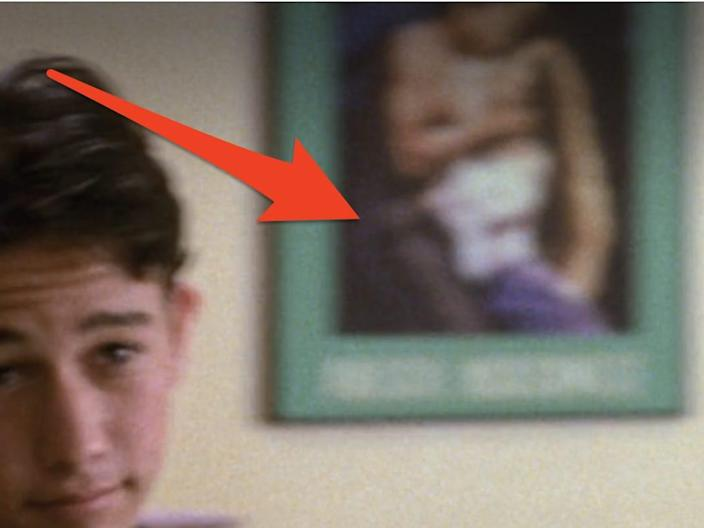 arrow pointing at poster on wall in 10 things i hate about you