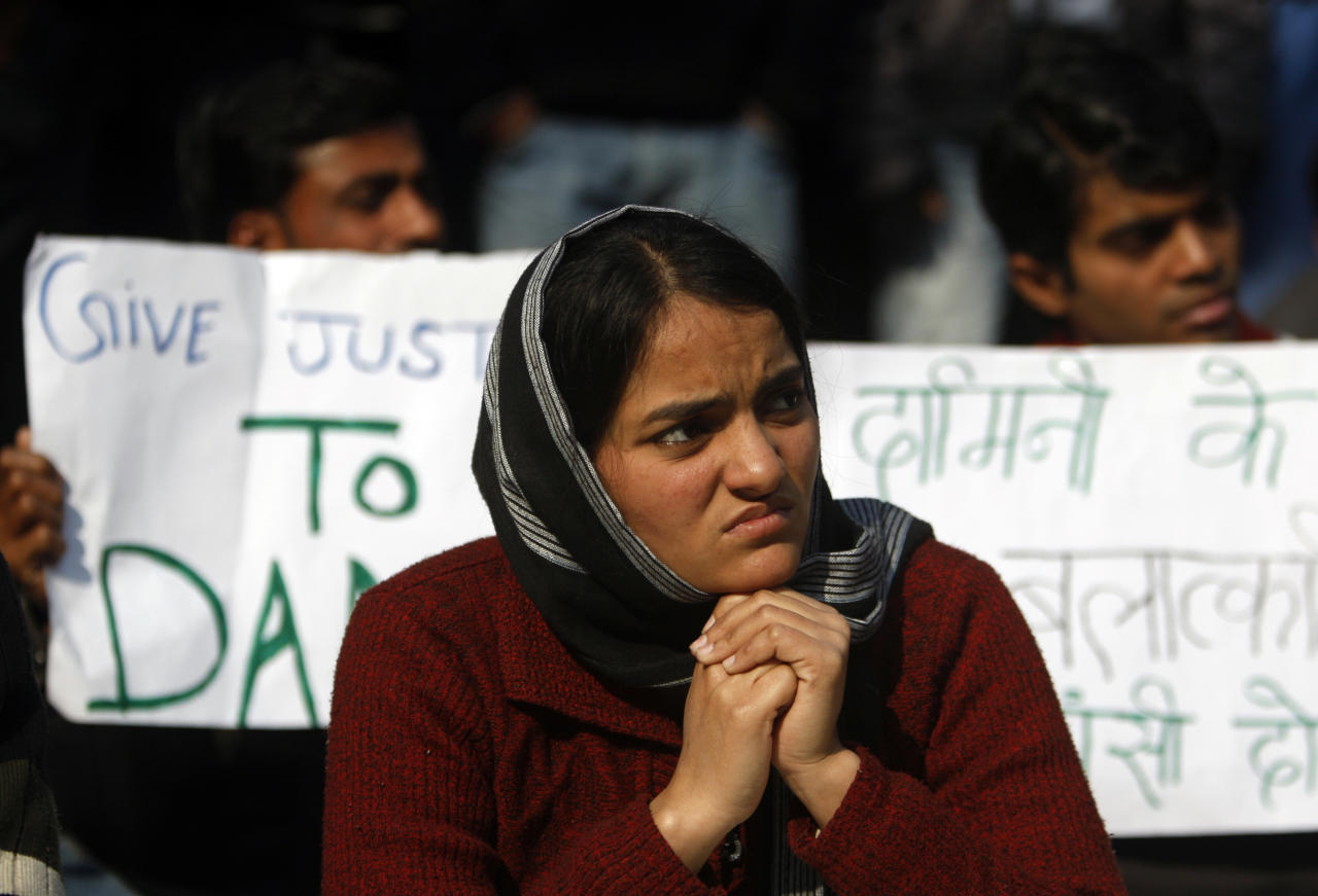 An India woman participates in a protest against the recent gang rape of a young woman in moving bus, in New Delhi, India, Monday, Jan. 7, 2013. An Indian magistrate ruled Monday that the media will not be allowed to attend pre-trial hearings or the trial of the five men accused of raping and killing a young student in the Indian capital, a police official said. (AP Photo/Tsering Topgyal)