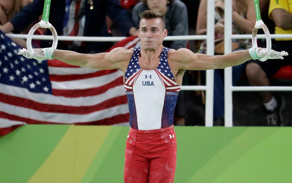 United States' Sam Mikulak performs on the rings during the artistic gymnastics men's qualification at the 2016 Summer Olympics in Rio de Janeiro, Brazil, Saturday, Aug. 6, 2016. (AP Photo/Dmitri Lovetsky)
