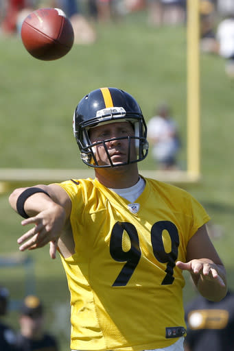 Pittsburgh Steelers quarterback Ben Roethlisberger wears a jersey with NO. 99 as he passes during the first practice at the team's NFL football training camp in Latrobe, Pa., on Saturday, July 26, 2014. Steelers defensive lineman Brett Keisel wore 99 and had not been re-signed with the team. (AP Photo)