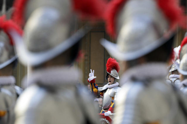 <p>A Vatican Swiss Guard recruit swears in during a ceremony at the San Damaso courtyard in Vatican City, May 6, 2017. The ceremony is held each May 6 to commemorate the day in 1527 when 147 Swiss Guards died protecting Pope Clement VII during the Sack of Rome. (Photo: Andrew Medichini/AP) </p>