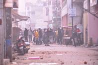 GHAZIABAD, INDIA - DECEMBER 20: Protesters pelt stones on police after Friday prayers amid anti CAA protests on December 12, 2019 in Ghaziabad, India. The act seeks to grant Indian citizenship to refugees from Hindu, Christian, Sikh, Buddhist and Parsi communities fleeing religious persecution from Pakistan, Afghanistan, and Bangladesh, and who entered India on or before December 31, 2014. The Parliament had passed the Citizenship (Amendment) Bill, 2019 last week and it became an act after receiving assent from President Ram Nath Kovind. Since then, protests including some violent ones have erupted in various regions of the country, including the North East over the amended citizenship law. (Photo by Sakib Ali/Hindustan Times via Getty Images)