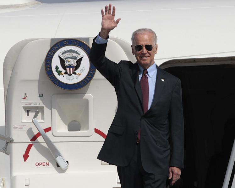 U.S. Vice President Joe Biden arrives at Borispol airport outside Kiev, Ukraine on Monday April 21, 2014. Vice President Joe Biden on Monday launched a high-profile visit to demonstrate the U.S. commitment to Ukraine and push for urgent implementation of an international agreement aimed at de-escalating tensions even as violence continues. Biden planned to meet Tuesday with government leaders who took over after pro-Russia Ukrainian President Viktor Yanukovych was ousted in February following months of protests. The White House said President Barack Obama and Biden agreed he should make the two-day visit to the capital city to send a high-level signal of support for reform efforts being pushed the new government. (AP Photo/Sergei Chuzavkov)