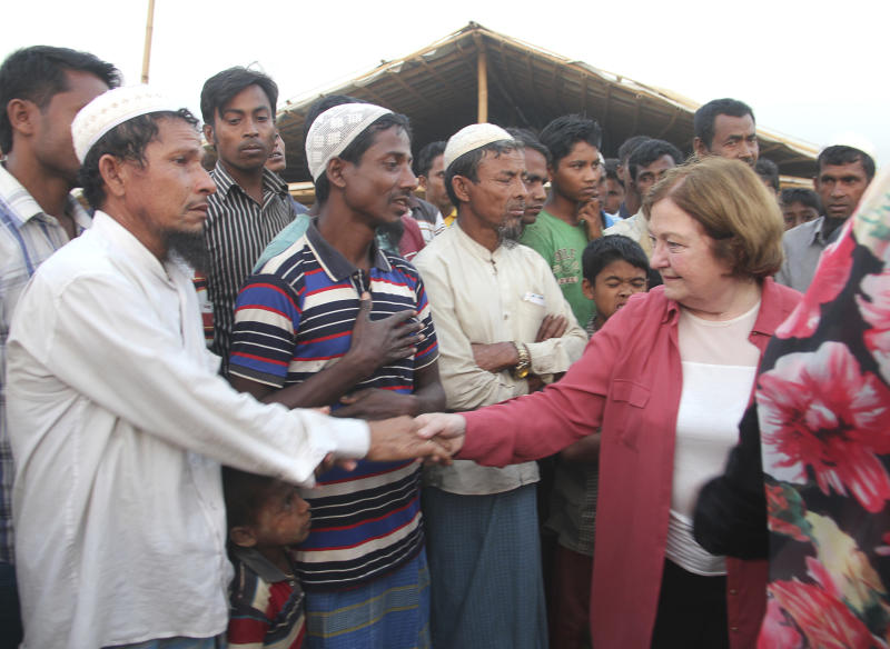 Noble Peace Laureate from northern Ireland Mairead Maguire, right, shakes hand with Rohingya refugees during her visit to Kutupalong refugee camp near Cox's Bazar, Bangladesh, Sunday, Feb. 25, 2018. Three female Nobel Peace Laureates began a weeklong trip to Bangladesh to meet Rohingya women who have been tortured, raped and even killed by Myanmar soldiers amid a delayed repatriation process. (AP Photo/Suzauddin Rubel)