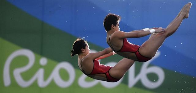 China's duet Chen Ruolin and Liu Huixia compete in the Women's Synchronised 10m Platform Final during the Rio 2016 Olympic Games, at the Maria Lenk Aquatics Stadium, on August 9 (AFP Photo/Martin Bureau)