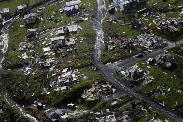 <p>Destroyed communities are seen in the aftermath of Hurricane Maria in Toa Alta, Puerto Rico, Thursday, Sept. 28, 2017. (Photo: Gerald Herbert/AP) </p>