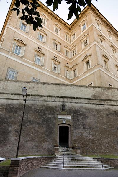 """A picture taken Tuesday, Jan. 28, 2014 showing an exterior view of the offices of the Vatican bank IOR at the Vatican. The Vatican bank's much-publicized financial reform has hit a small glitch: The bank told dozens and perhaps hundreds of widows and Vatican pensioners that they had to close their accounts or risk losing access to their money as part of Pope Francis' reform efforts. Only the bank now says these account-holders were targeted as a result of a """"technical error"""" and are being kept on as clients after all, an embarrassing rollback that comes as the Vatican seeks to mend ties with Italian authorities who have long suspected Italians were using the Vatican as an off-shore tax haven, The Associated Press has learned. Bank President Ernst Von Freyberg penned a letter to these clients Sept. 19, telling them to come to the bank before Nov. 30 to transfer their money out because they no longer fit the criteria of account-holders set by the board. He warned that if they didn't meet the deadline, their money would become subject to the """"internal dispositions"""" of the bank, according to a copy of the letter obtained by AP. (AP Photo/Domenico Stinellis)"""