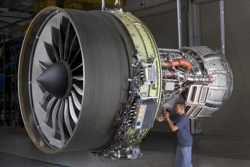A worker inspects an aviation turbine