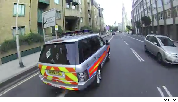 Police car's near miss with cyclist