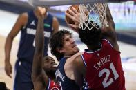 Philadelphia 76ers guard Shake Milton, left, and center Joel Embiid (21) defend as Dallas Mavericks center Boban Marjanovic, center, works to take a shot in the first half of an NBA basketball game in Dallas, Monday, April 12, 2021. (AP Photo/Tony Gutierrez)