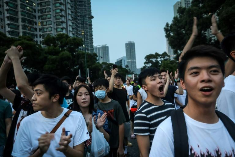 Research by academics has shown that half of those protesting on Hong Kong's streets are between 20 and 30 years old but elderly people have also marched (AFP Photo/VIVEK PRAKASH)