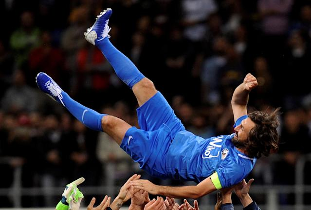 Former Italian soccer player Andrea Pirlo is lifted up at the end of his farewell soccer match at the San Siro stadium in Milan, Italy, May 21, 2018. REUTERS/Daniele Mascolo TPX IMAGES OF THE DAY