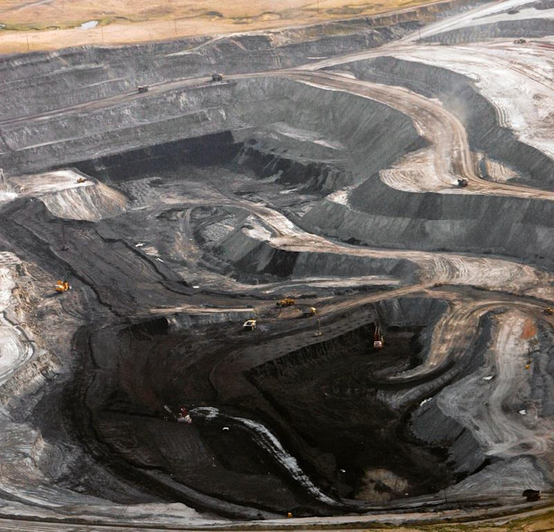 A coal mine is seen from the air near Gillette, Wyo., on Aug. 22, 2006. As one of the largest energy producers in the nation, Wyoming is no stranger to the debate over global warming. The state has tried to address climate change head-on without swerving from its energy-dependent economy.