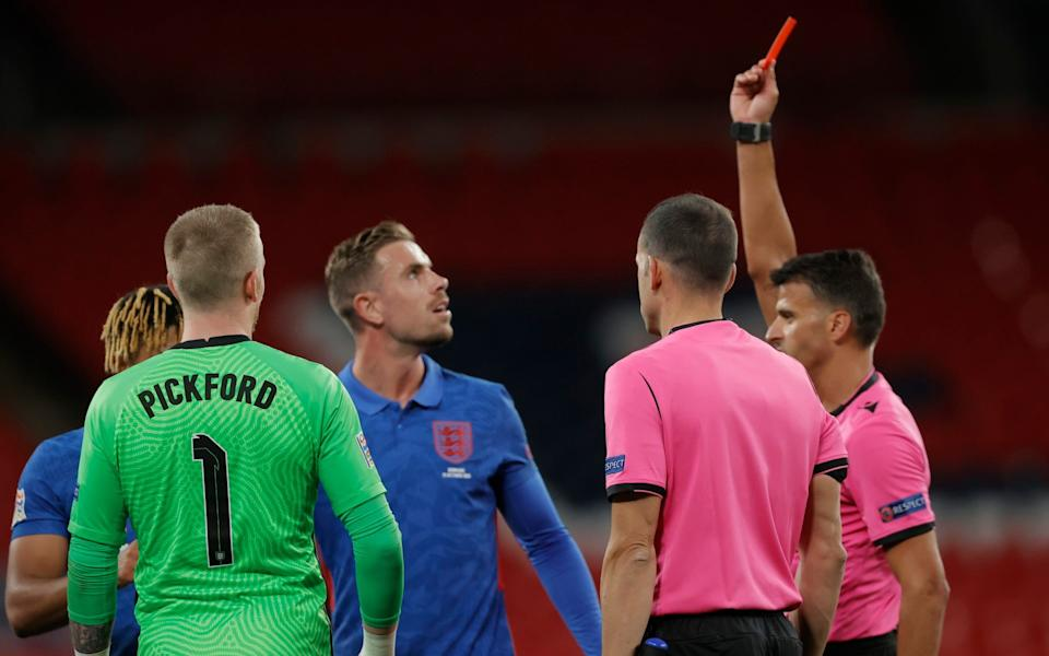 Reece James of England gets a red card at end of gamebfrom referee Jesús Gil Manzano at end of the England v Denmark UEFA Nations League Group B match at Wembley Stadium on October 14th 2020 in Londo - NMC Pool/Tom Jenkins