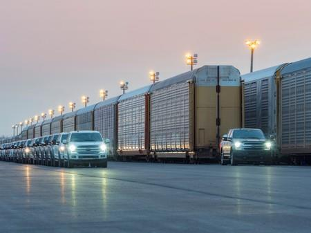 An all-electric Ford F-150 prototype tows more than 1.25 million pounds of rail cars and trucks during a test in Dearborn