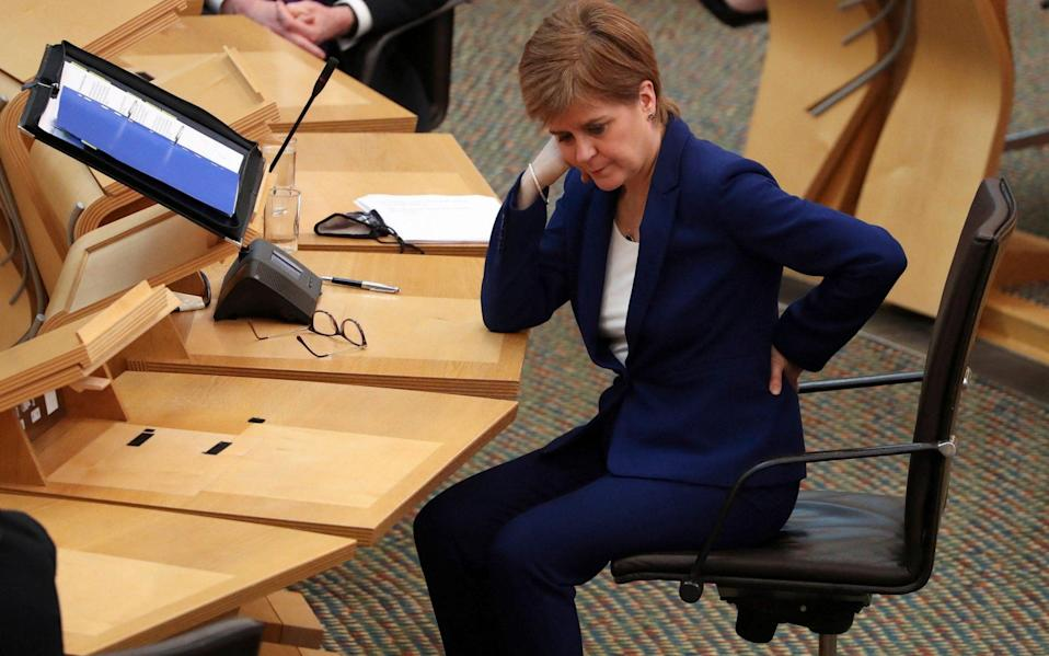 Scotland's First Minister Nicola Sturgeon is seen during a session where she delivered an update on the Covid-19 pandemic to Members of the Scottish Parliament (MSPs) inside the chamber of the Scottish Parliament - AFP