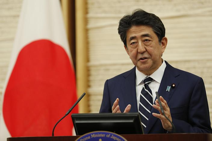 Shinzo Abe, Japan's prime minister, speaks during a news conference in Tokyo, Japan, on Monday, May 25, 2020. The Japanese government is set to end its nationwide state of emergency by lifting the order for Tokyo, its surrounding areas and Hokkaido on Monday, allowing more parts of the economy to re-open as new coronavirus cases tail off. (Kim Kyung-Hoon /Reuters/Bloomberg via Getty Images)