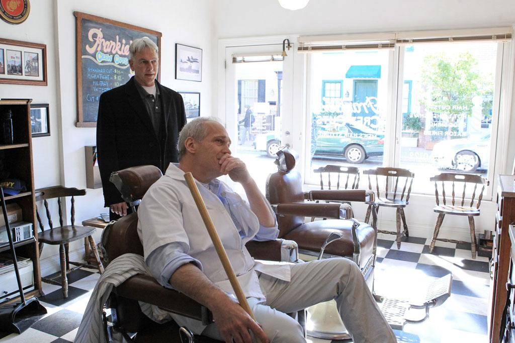 """""""Prime Suspect"""" -- A media frenzy surrounding an unidentified criminal prompts Gibbs' (Mark Harmon, left) barber (Jay Acovone, right) to question his son's involvement and ask for Gibbs' help in ruling out his son as a prime suspect."""