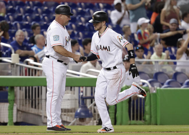 Miami Marlins third base coach Fredi Gonzalez, left, shakes hands with JT Riddle as he rounds the bases on a solo home run during the fifth inning of a baseball game against the San Francisco Giants, Thursday, June 14, 2018, in Miami. (AP Photo/Lynne Sladky)