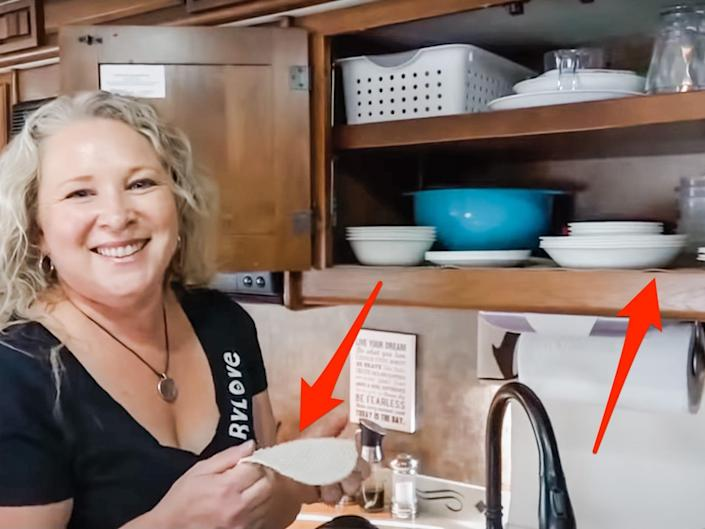 Julie holds a liner with the cabinets open