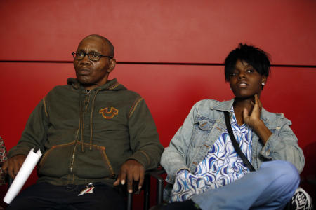 Freddie Gray's stepfather Richard Shipley, lef, sits with Fredricka Gray during a press availability at the Reginald F. Lewis Museum of Maryland African American History and Culture, Friday, May 1, 2015 in Baltimore. State's Attorney Marilyn J. Mosby announced criminal charges against all six officers suspended after Freddie Gray suffered a fatal spinal injury while in police custody in Baltimore. (AP Photo/Alex Brandon)