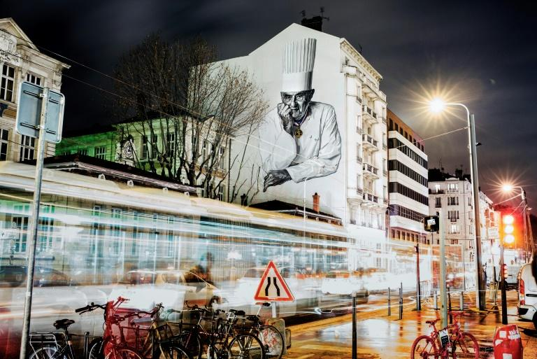 A mural of French chef Paul Bocuse is painted on the side of a building in Lyon, eastern France