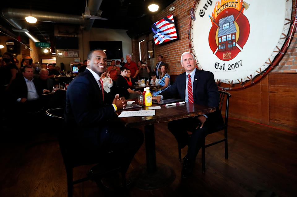 Vice President Mike Pence and Republican U.S. Senate candidate John James sit for lunch at The Engine House in Mount Clemens, Michigan, in June. (Photo: ASSOCIATED PRESS)
