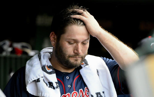 Minnesota Twins starting pitcher Lance Lynn (31) stands in the dugout after being relieved during the second inning of an baseball game against the Chicago Cubs on Sunday, July 1, 2018, in Chicago. (AP Photo/Matt Marton)