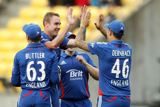Stuart Broad of England celebrates with teammate Jade Dernbach after taking the wicket of Hamish Rutherford of New Zealand during the third Twenty20 International match between New Zealand and England at Westpac Stadium on February 15, 2013 in Wellington, New Zealand.  (Photo by Hagen Hopkins/Getty Images)