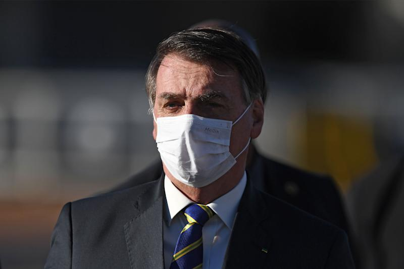 Brazilian President Jair Bolsonaro wears a face mask as he arrives at the flag-raising ceremony before a ministerial meeting at the Alvorada Palace in Brasilia, on May 12, 2020, amid the new coronavirus pandemic. (Photo by EVARISTO SA / AFP) (Photo by EVARISTO SA/AFP via Getty Images)