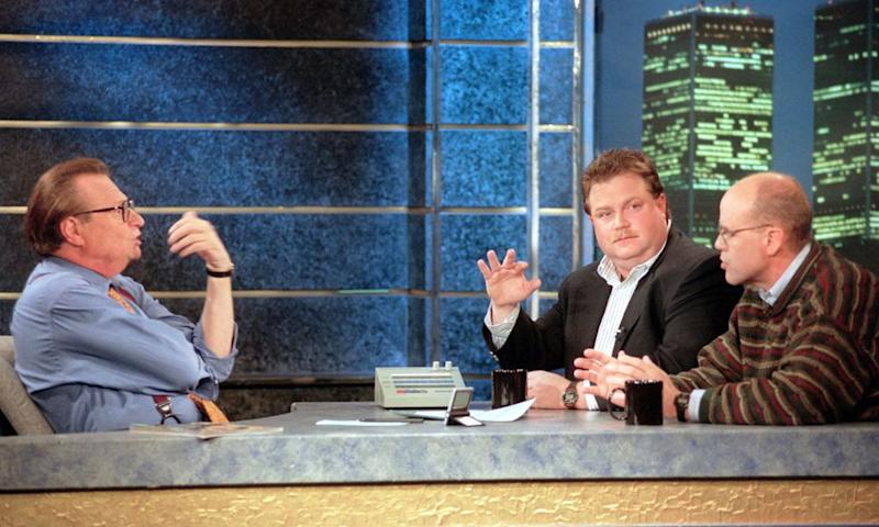 Richard Jewell (second from right) with his attorney Watson Bryant on Larry King's show | Todd Plitt/AP/Shutterstock