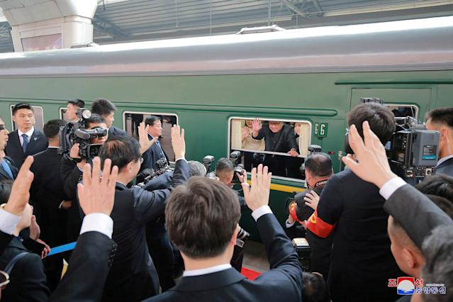 <p>North Korean leader Kim Jong Un waves from a train, as he paid an unofficial visit to China, in this undated photo released by North Korea's Korean Central News Agency (KCNA) in Pyongyan, March 28, 2018. (Photo: KCNA/via Reuters) </p>