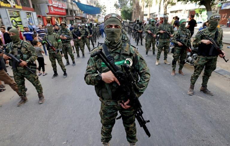 Members of the Al-Qassam brigades, the armed wing of Palestinian group Hamas, march in Gaza City on May 22, 2021, in commemoration of senior Hamas commander Bassem Issa who was killed along with others in Israeli air strikes