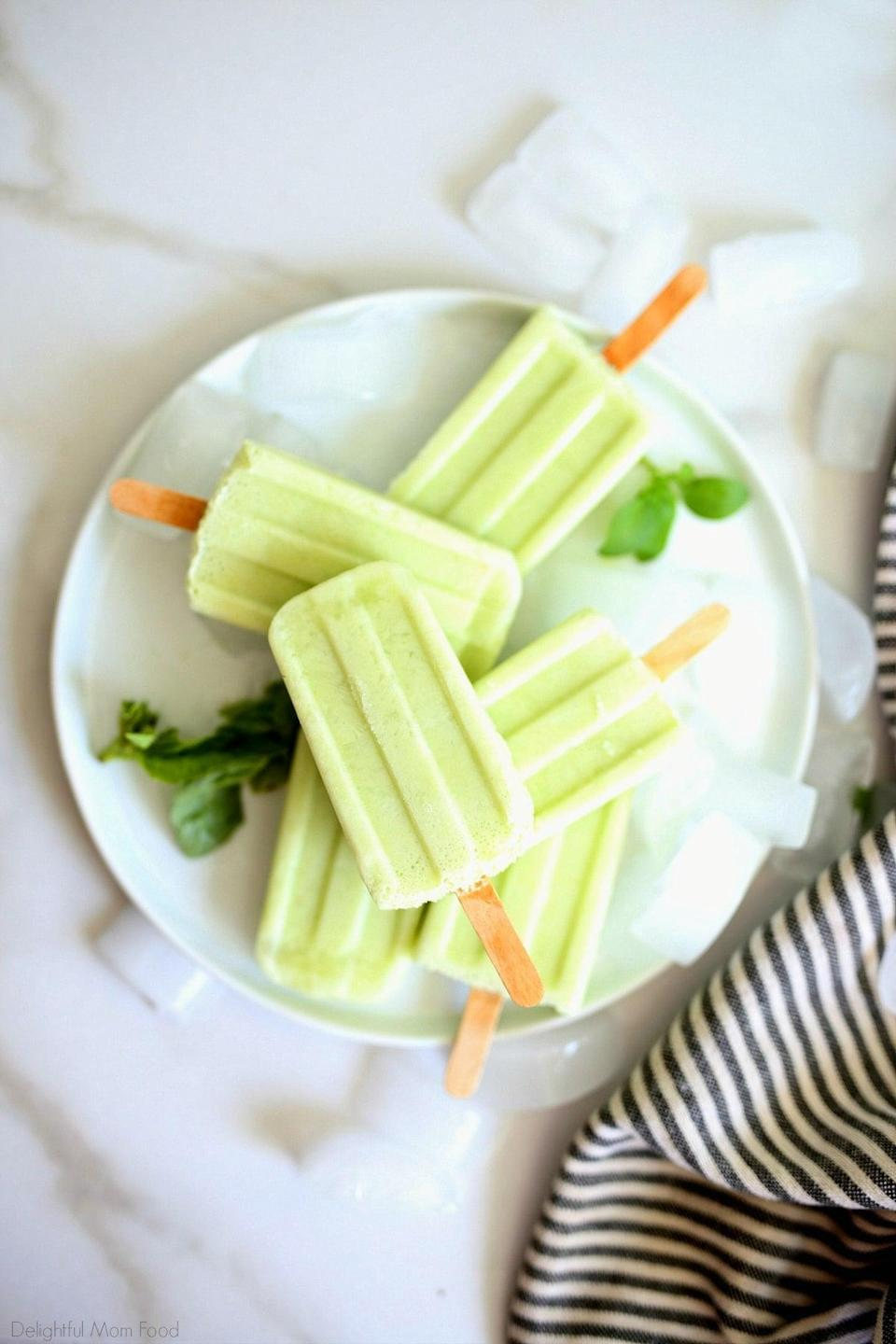 """<p>If you're craving something zesty and fresh, we recommend these bright green pops. Made with nonfat Greek yogurt and lime juice, these are too good to be true.</p> <p><strong>Get the recipe</strong>: <a href=""""https://delightfulmomfood.com/basil-lemon-popsicle-recipe/"""" class=""""link rapid-noclick-resp"""" rel=""""nofollow noopener"""" target=""""_blank"""" data-ylk=""""slk:basil lemon popsicles"""">basil lemon popsicles</a></p>"""