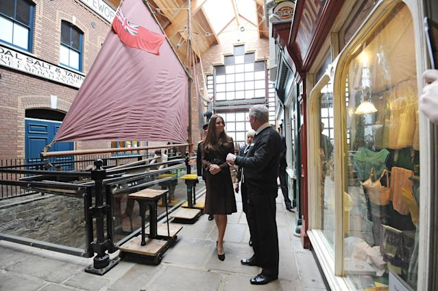 GRIMSBY, ENGLAND - MARCH 05: Catherine, The Duchess of Cambridge talks to former trawler-man John Vincent during her tour of the National Fishing Heritage Centre on March 5, 2013 in Grimsby, England. (Photo Anna Gowthorpe - WPA Pool/Getty Images)