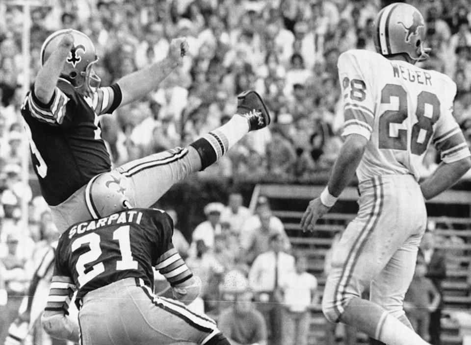 Saints kicker Tom Dempsey lets the record-setting kick fly. (Getty Images Archive)