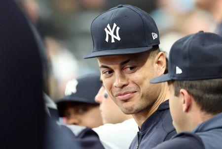 May 11, 2019; St. Petersburg, FL, USA; New York Yankees outfielder Giancarlo Stanton (27) looks on from the dugout against the Tampa Bay Rays at Tropicana Field. Mandatory Credit: Kim Klement-USA TODAY Sports