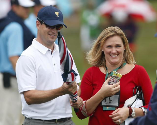 Zach Johnson of the U.S. and his wife Kim Barclay react after he won his match against Branden Grace of South Africa during the Singles matches for the 2013 Presidents Cup golf tournament at Muirfield Village Golf Club in Dublin, Ohio October 6, 2013. REUTERS/Chris Keane (UNITED STATES - Tags: SPORT GOLF)