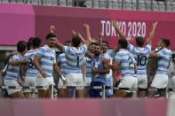 Argentina players celebrate their win over Britain in their men's rugby sevens bronze medal match at the 2020 Summer Olympics, Wednesday, July 28, 2021 in Tokyo, Japan. (AP Photo/Shuji Kajiyama)