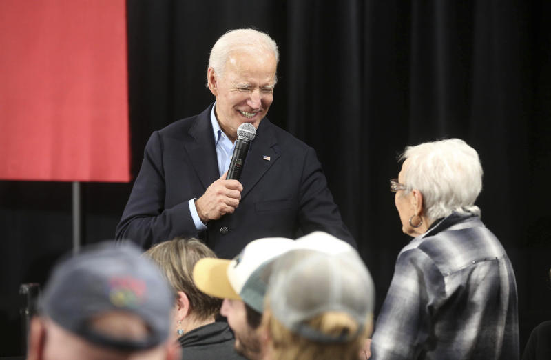 "Democratic presidential candidate and former Vice President Joe Biden speaks with Marjorie Costigan, of Elkader, Iowa, during his ""No Malarkey"" bus tour at Johnson's Reception Hall in Elkader, Iowa, on Friday, Dec. 6, 2019. (Jessica Reilly/Telegraph Herald via AP)"