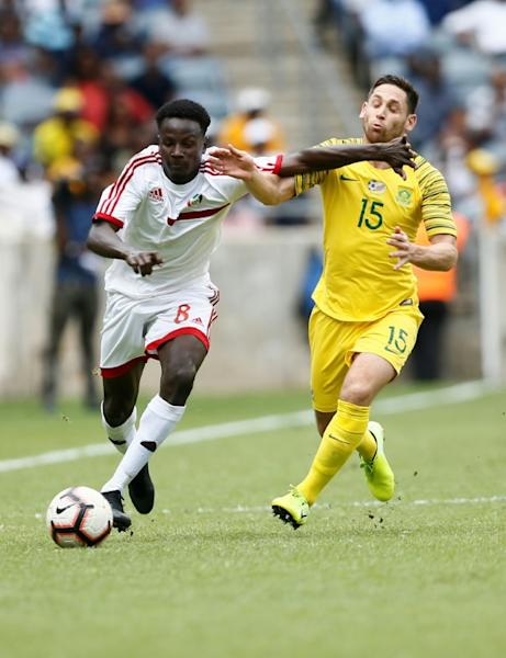 Mohamed Mahmoud (L) of Sudan holds off Dean Furman of South Africa during an Africa Cup of Nations qualifier in Soweto Sunday (AFP Photo/Phill Magakoe)