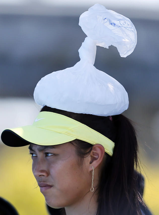 Taiwan's Chan Hao-ching with ice pack on her head, watches the first round match between Christina McHale of the U.S. and Chan Yung-Jan of Taiwan during their first round match at the Australian Open tennis championship in Melbourne, Australia, Tuesday, Jan. 14, 2014. (AP Photo/Shuji Kajiyama)