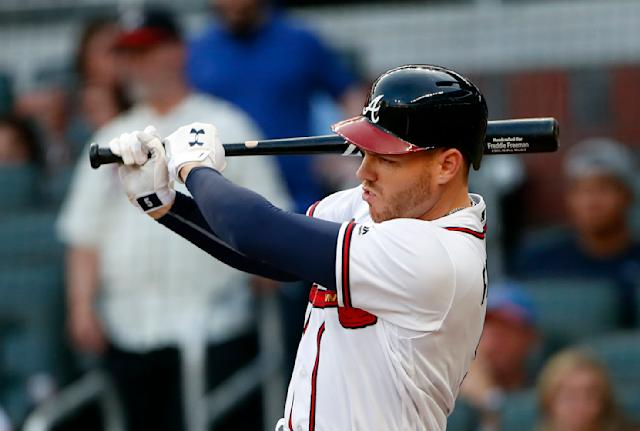 Atlanta Braves' Freddie Freeman drives in a run with a base hit during the first inning of the team's baseball game against the Chicago Cubs on Wednesday, May 16, 2018, in Atlanta. (AP Photo/John Bazemore)