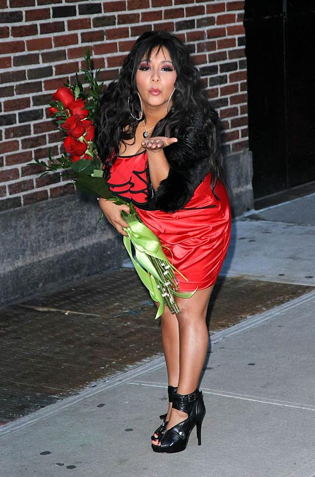 "Looking a little like a Disney character herself, Nicole ""Snooki"" Polizzi blew kisses to her fans outside ""Late Show With David Letterman"" in NYC Monday. The reality starlet promoted her new novel, <i>A Shore Thing</i>, by reading the Top 10 list on the show. The night's subject? ""Top 10 Reasons to Buy the New Snooki Book."" Jackson Lee/<a href=""http://www.splashnewsonline.com"" target=""new"">Splash News</a> - January 10, 2011"