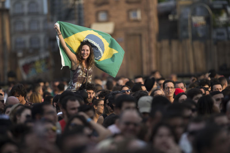 A fan holds a Brazilian flag during the Ultraje a Rigor show at the Rock in Rio music festival in Rio de Janeiro, Brazil, Saturday, Sept. 26, 2015. (AP Photo/Felipe Dana)