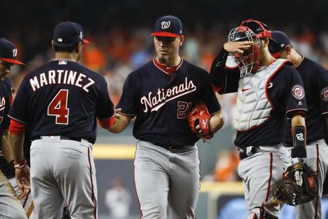 Washington Nationals manager Dave Martinez, left, takes relief pitcher Tanner Rainey out of the game against the Houston Astros during the seventh inning of Game 1 of the baseball World Series Tuesday, Oct. 22, 2019, in Houston. (AP Photo/Matt Slocum)