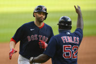 Boston Red Sox's J.D. Martinez, left, is congratulated by third base coach Carlos Febles as he runs bases during a two-run home run over center field the seventh inning of a baseball game against the Atlanta Braves, Sunday, Sept. 27, 2020, in Atlanta. (AP Photo/John Amis)
