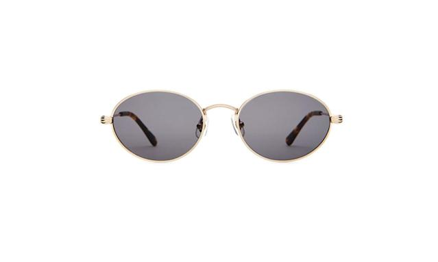 "<p>The New Riddim $75, <a href=""https://www.crapeyewear.com/products/the-new-riddim-gold-metal-grey-oval-sunglasses"" rel=""nofollow noopener"" target=""_blank"" data-ylk=""slk:crapeyewear.com"" class=""link rapid-noclick-resp"">crapeyewear.com</a> </p>"