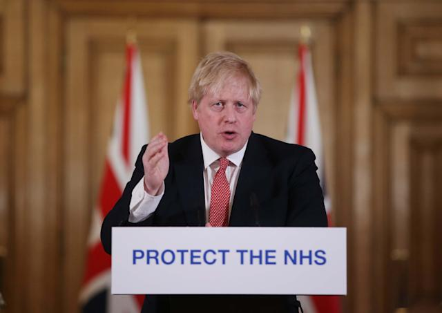 Boris Johnson is expected to reveal measures to end lockdown in a public address on Sunday. (Ian Vogler-WPA Pool/Getty Images)
